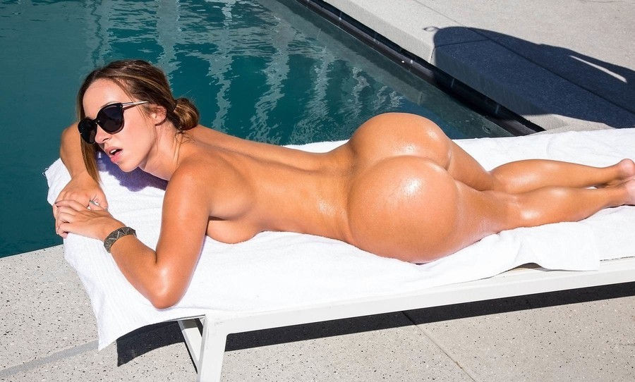 Brunette posing next to the pool with perfect ass