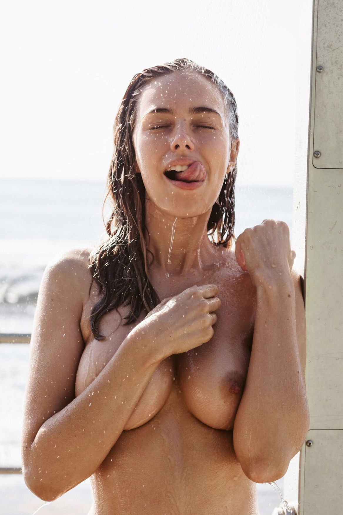 Brunette enjoying a good shower