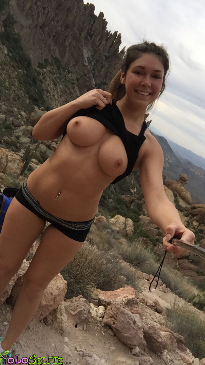 Brunette gets selfie showing her tits outdoors