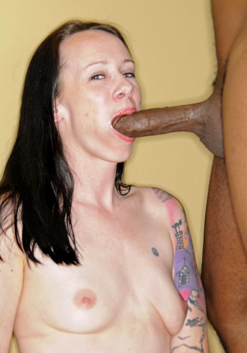 Tattoed brunette sucks black cock