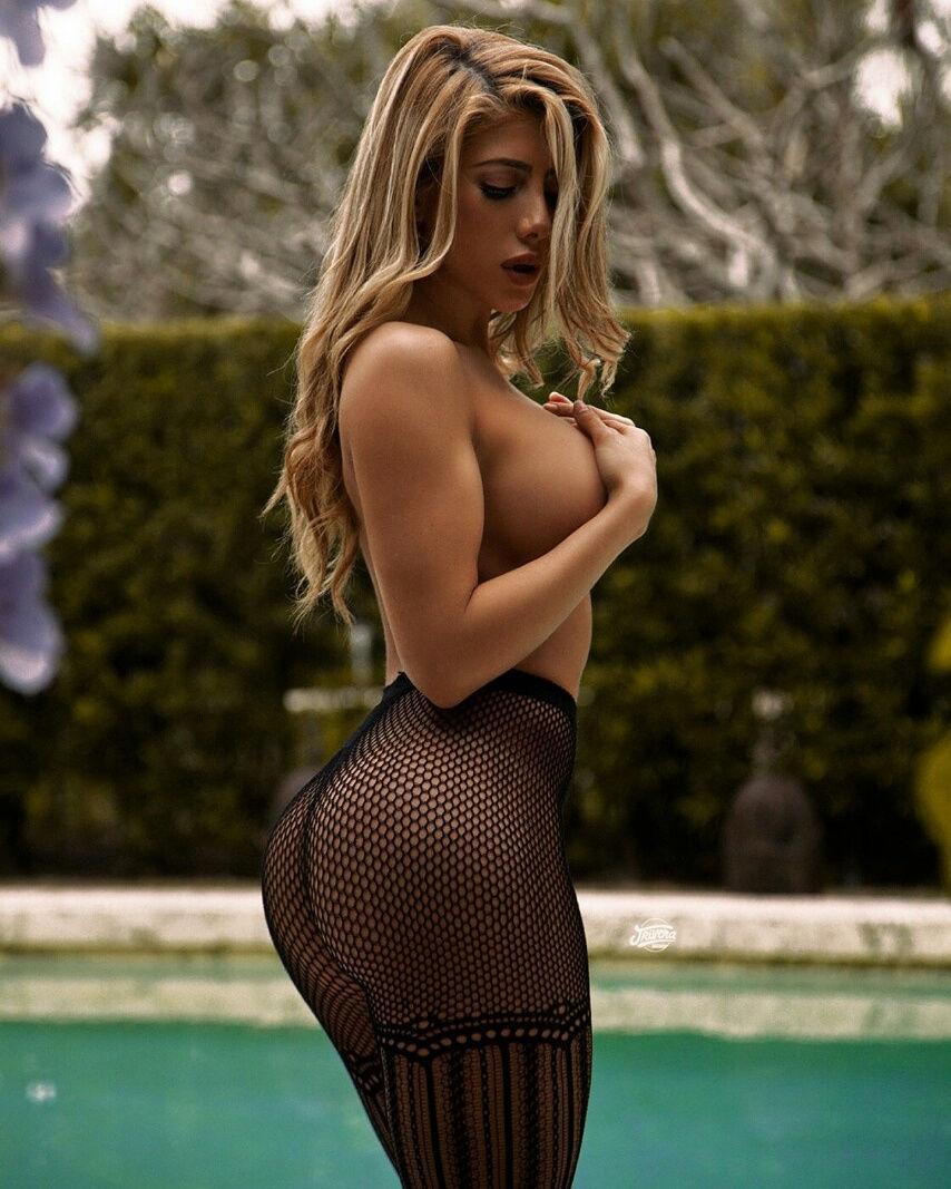 Wearing Nothing but black fish stockings..wowza!