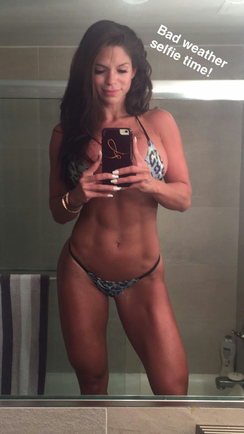 Michelle Lewin in a bikini taking a selfie