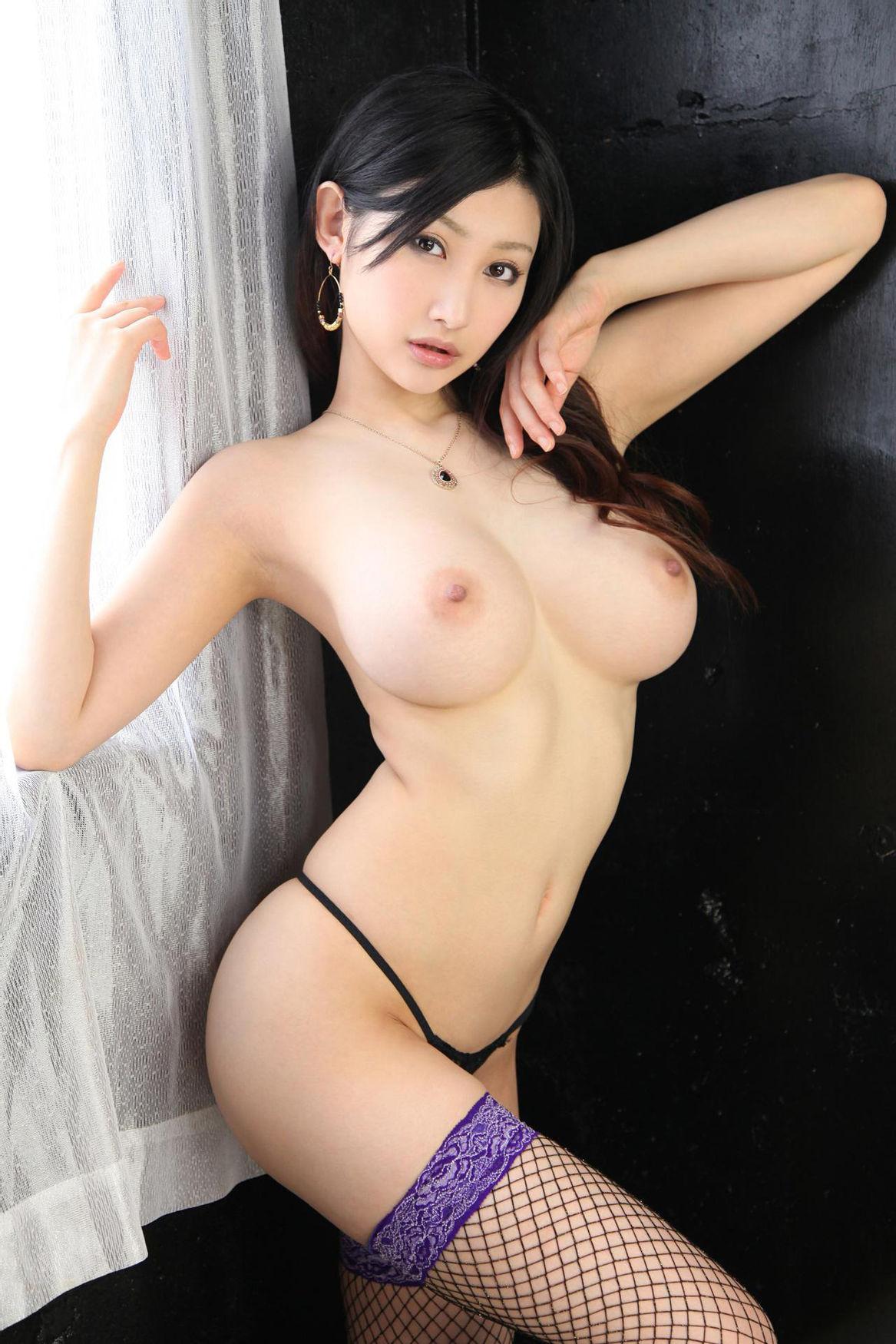Sensual erotic asian topless thin woman stock photo