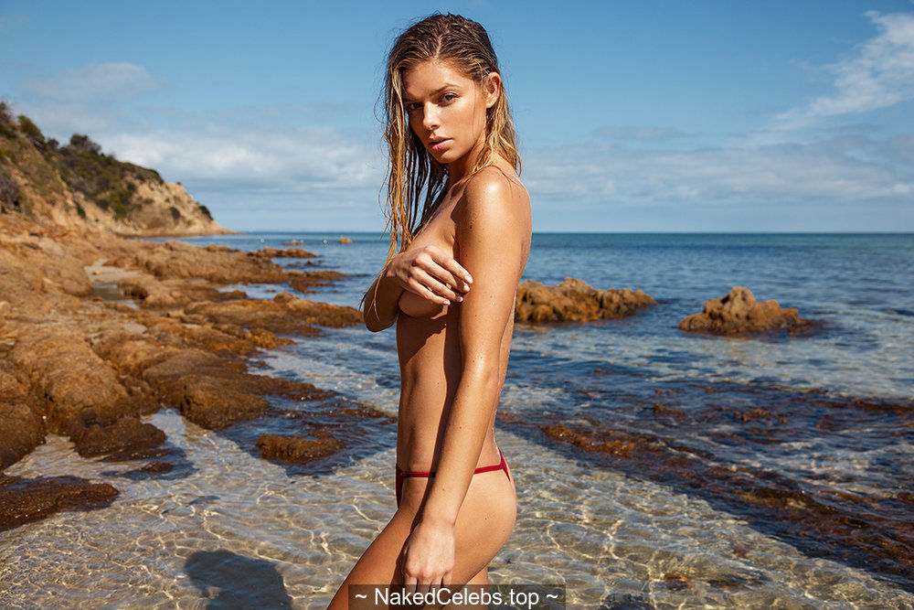 Danielle Knudson in bikini and braless on a beach