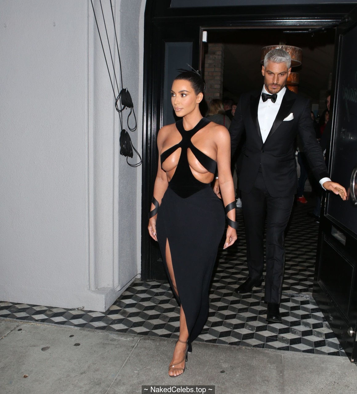 Kim Kardashian almost topless in sexy dress