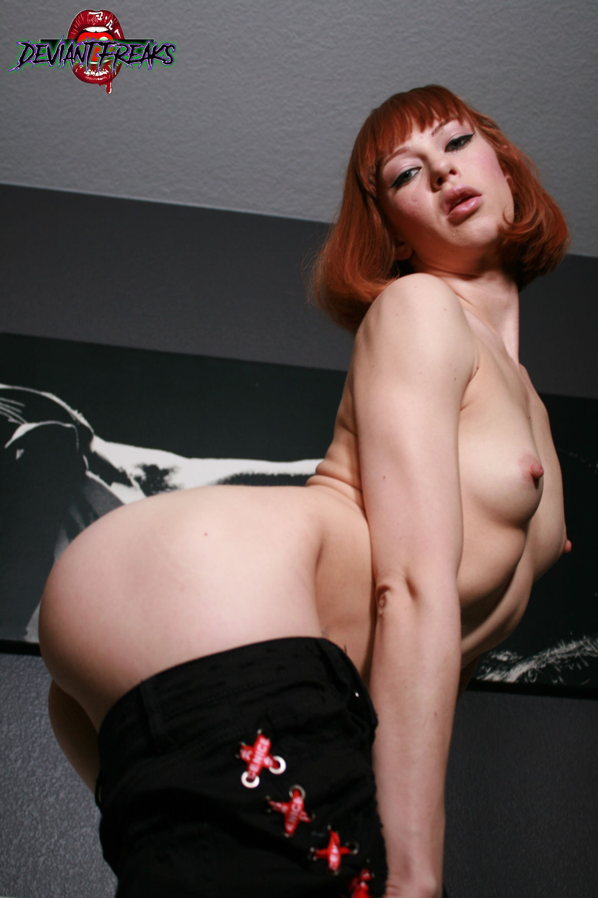 redhead sex actress DeviantFreaks cute butt and thigh boot from the pornstar's free photos