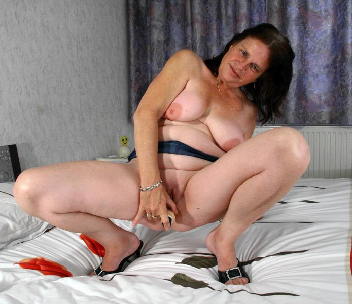 Mature woman masturbates with sex toy