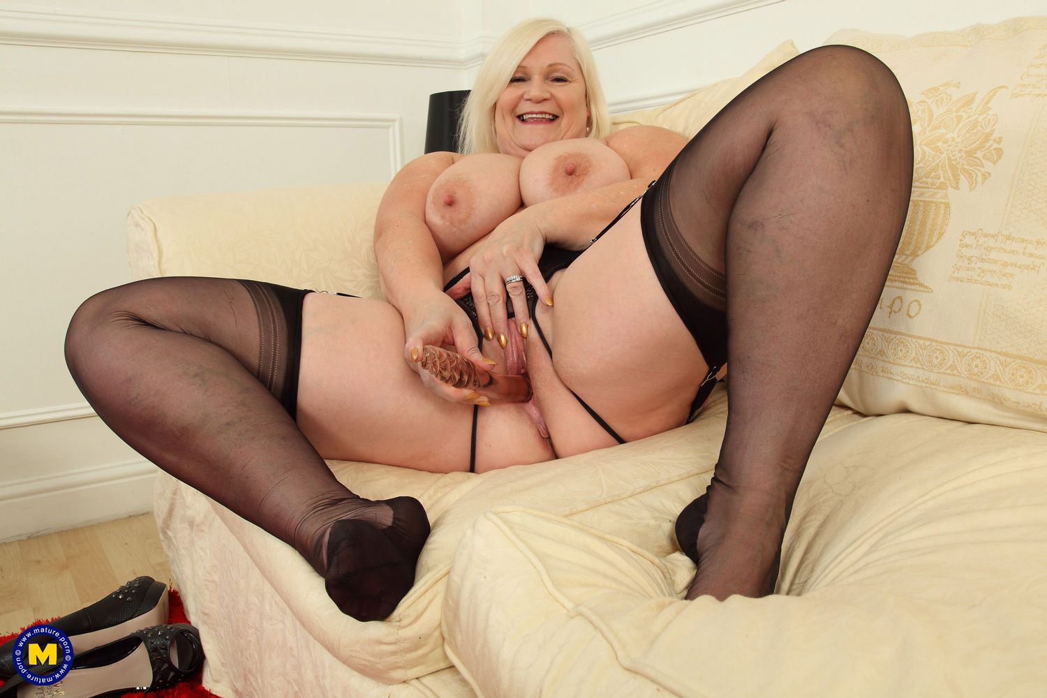 big breasted curvy British housewife plugs hairy pussy with a big toy in nylon stockings and und ...