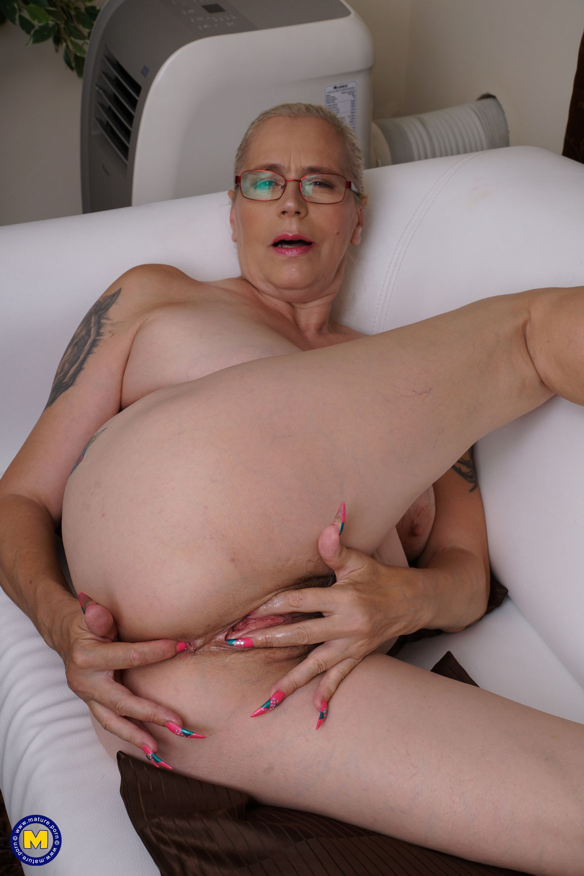 mature granny masturbates and fingering her hairy old pussy