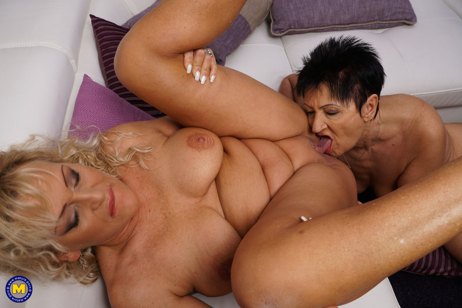 Two naughty mature lesbians have great fun together and kissing. Mature lesbian rimming and puss ...