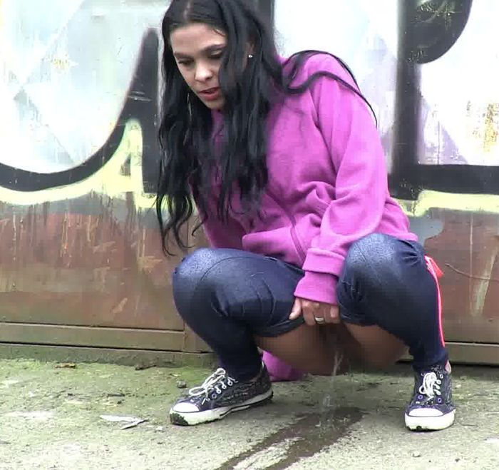 Black haired girl pissing in public