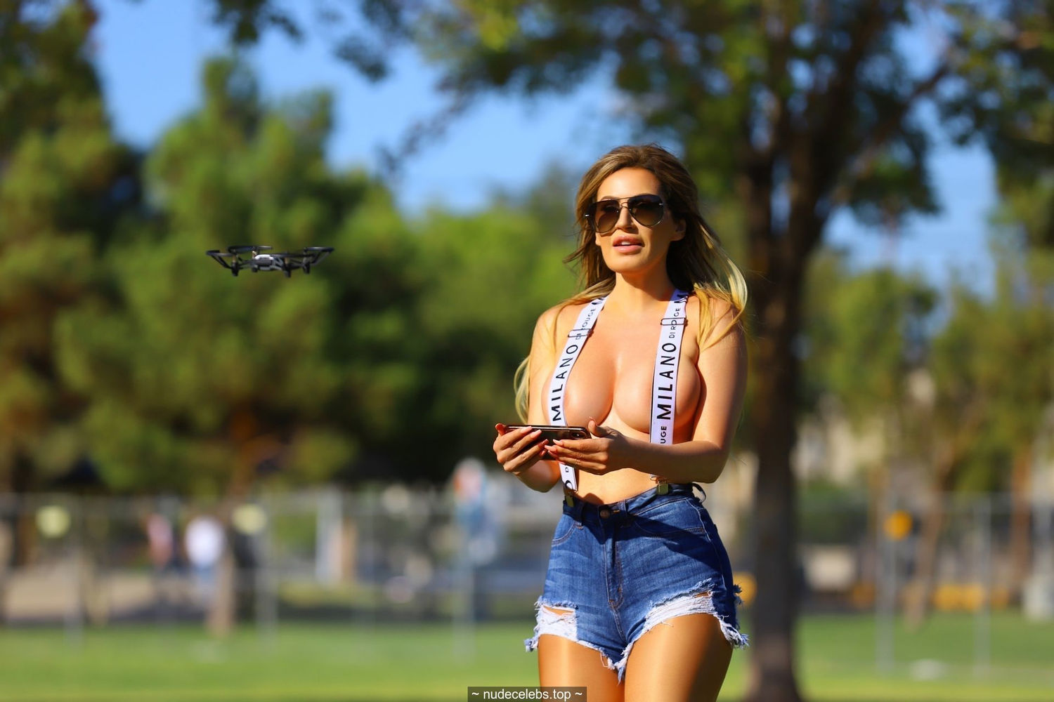 Busty Ana Braga almost topless with quadrocopter