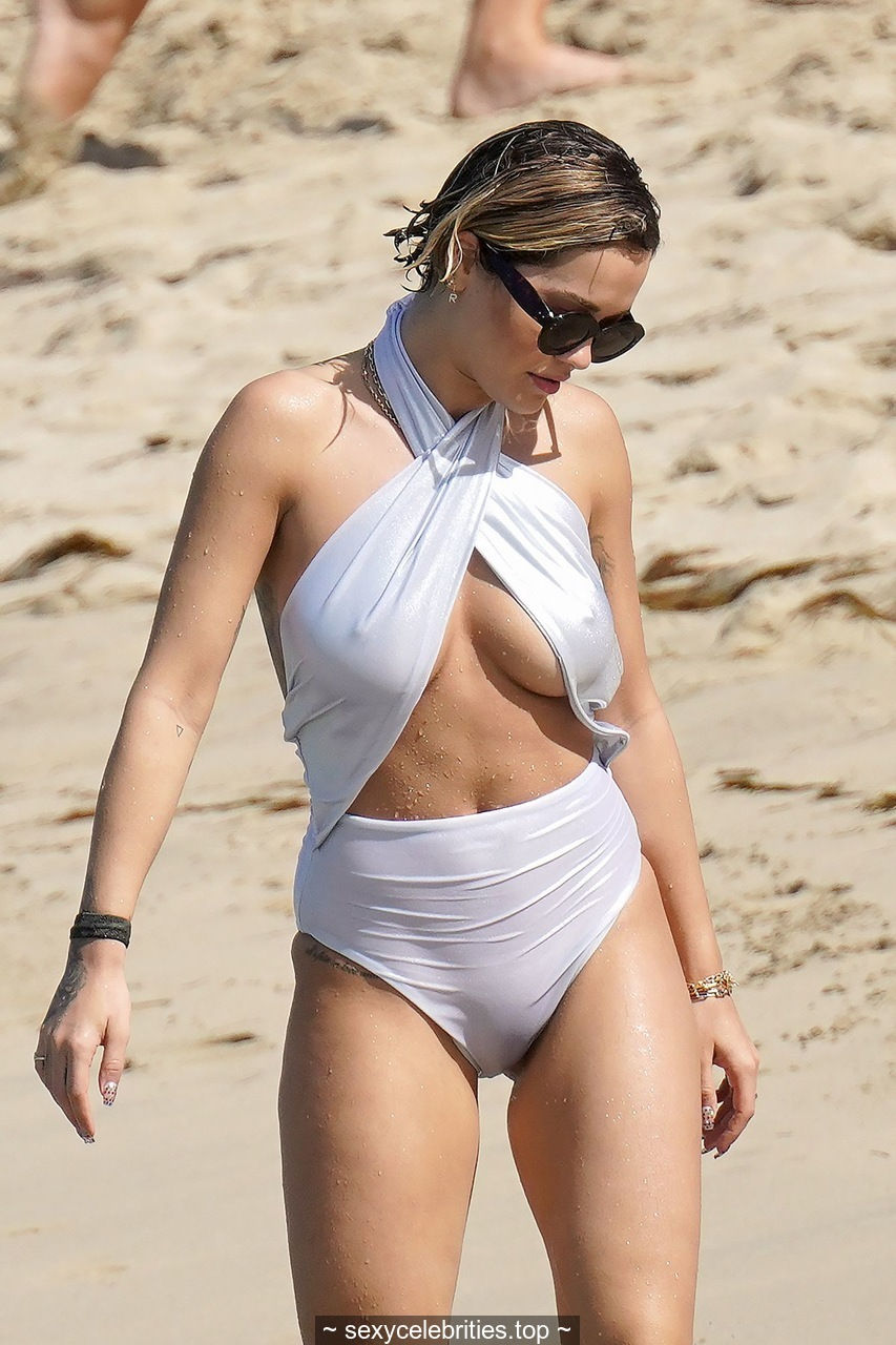 Rita Ora camel toe and pokies in white monokini on the beach