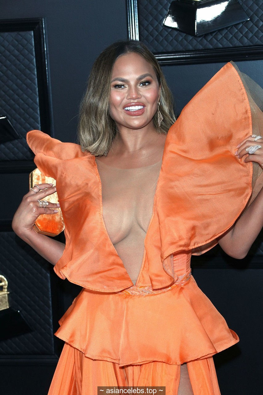 Chrissy Teigen sexy cleavage at 62nd Annual GRAMMY Awards