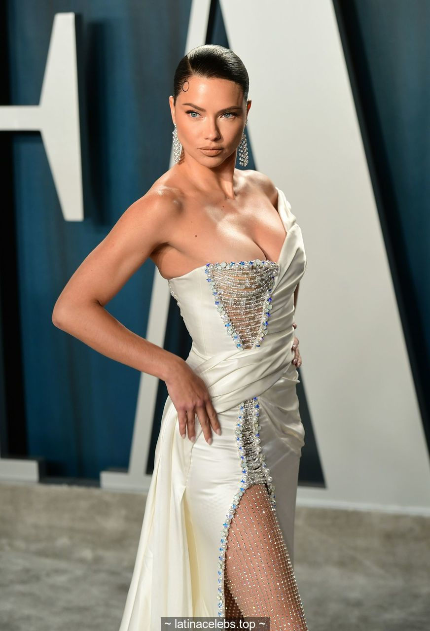 Adriana Lima sexy legs and cleavage at 2020 Vanity Fair Oscar Party in Beverly Hills