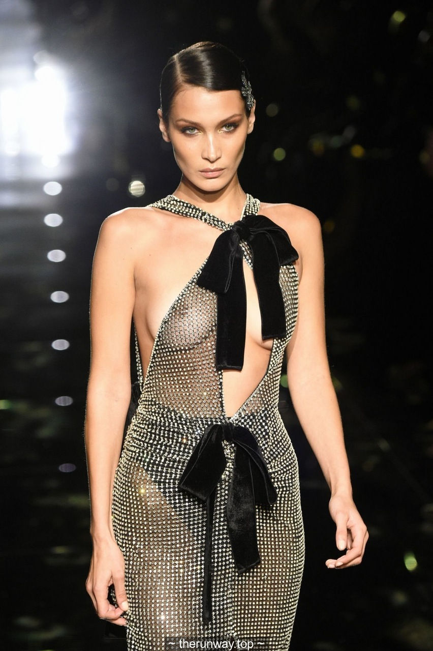 Bella Hadid braless in see through dress