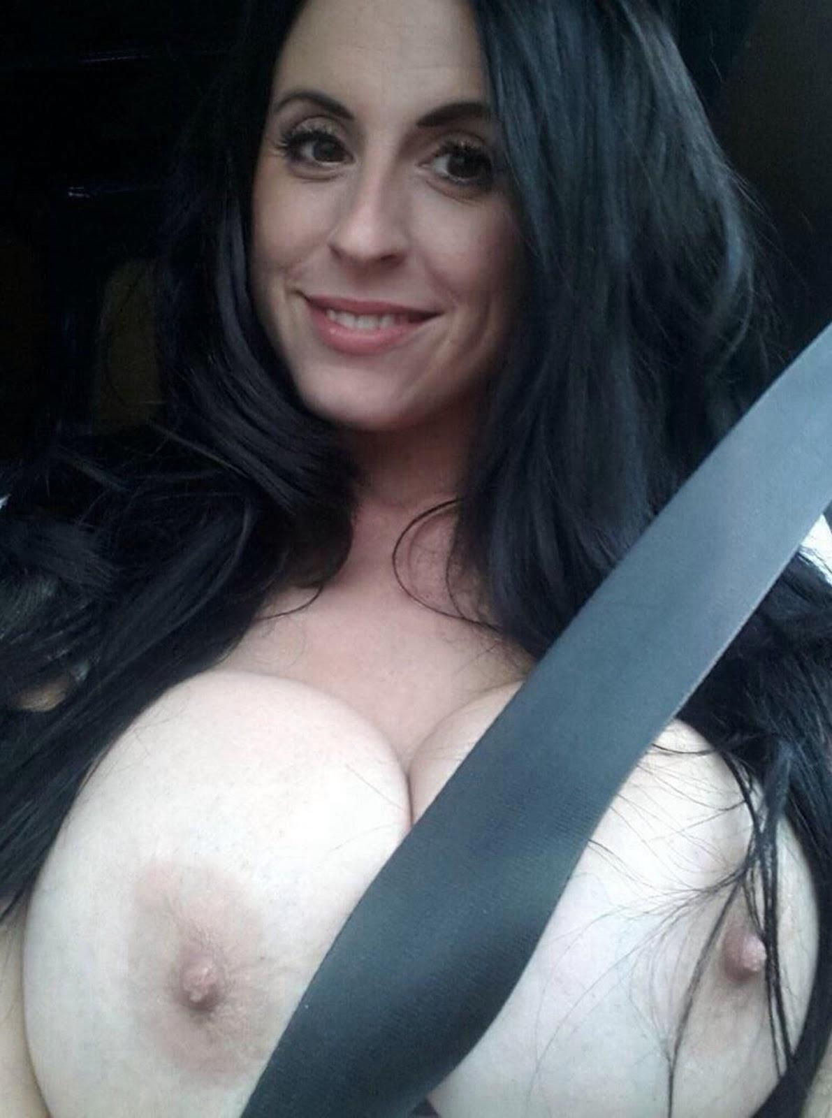 Busty brunette women uncovering her big tits sitting in the car