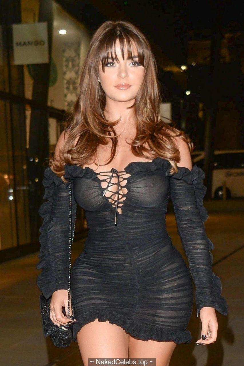 Demi Rose braless in see through mini dress