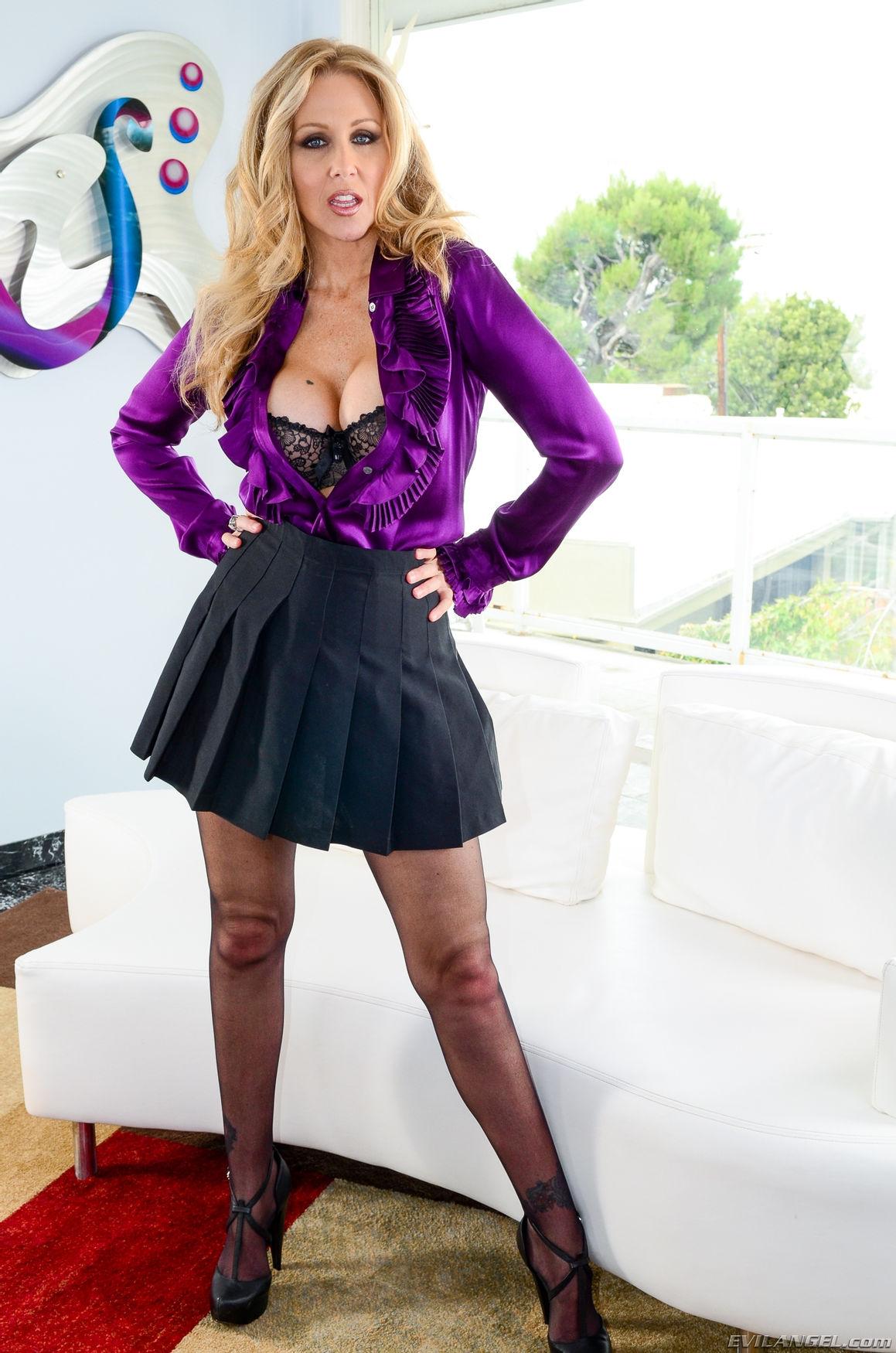 Non nude busty mature pornstar blonde Julia Ann huge boobs in lace bra wearing short skirt, nylo ...