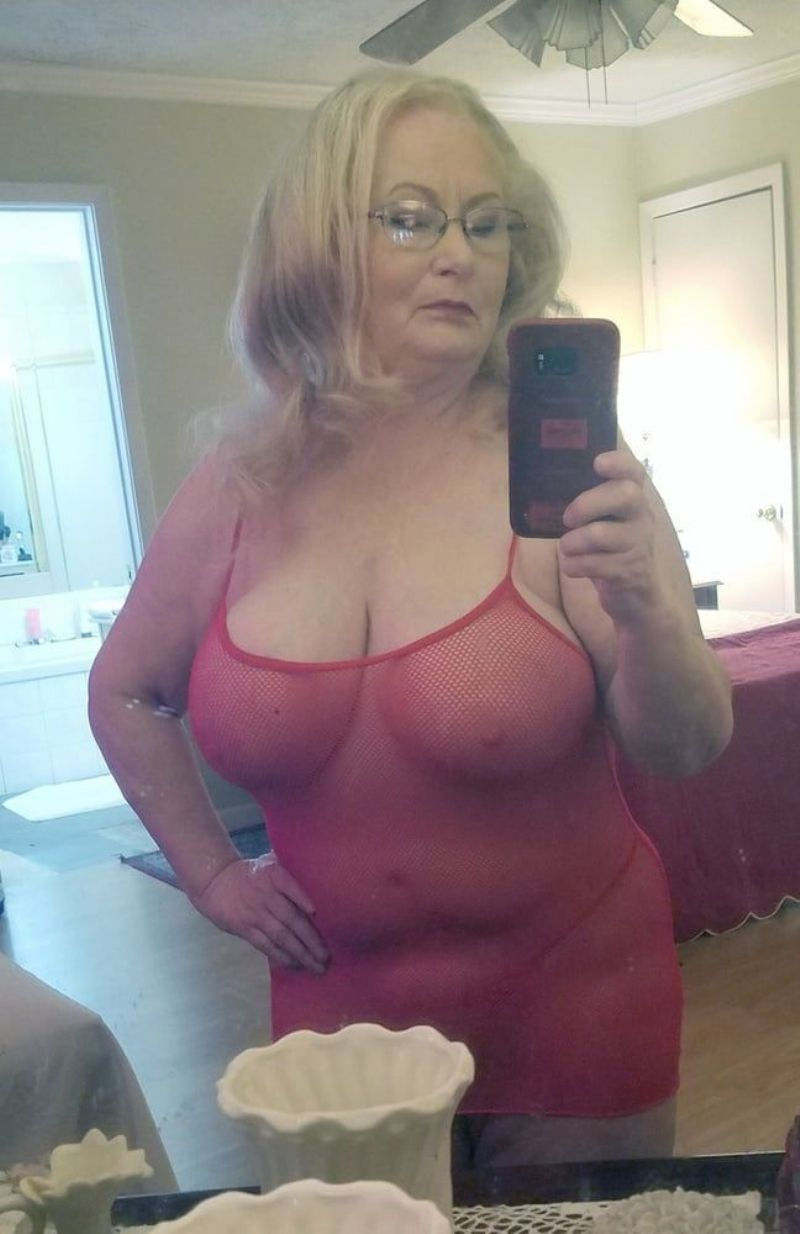 Old lady takes nude self shot in bedroom mirror