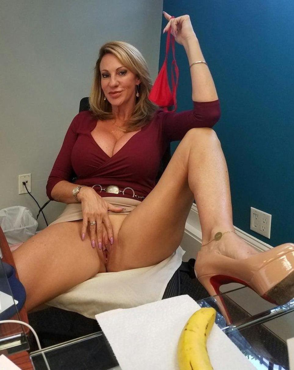 Sexy beautiful MILF woman taking off her thongs panties