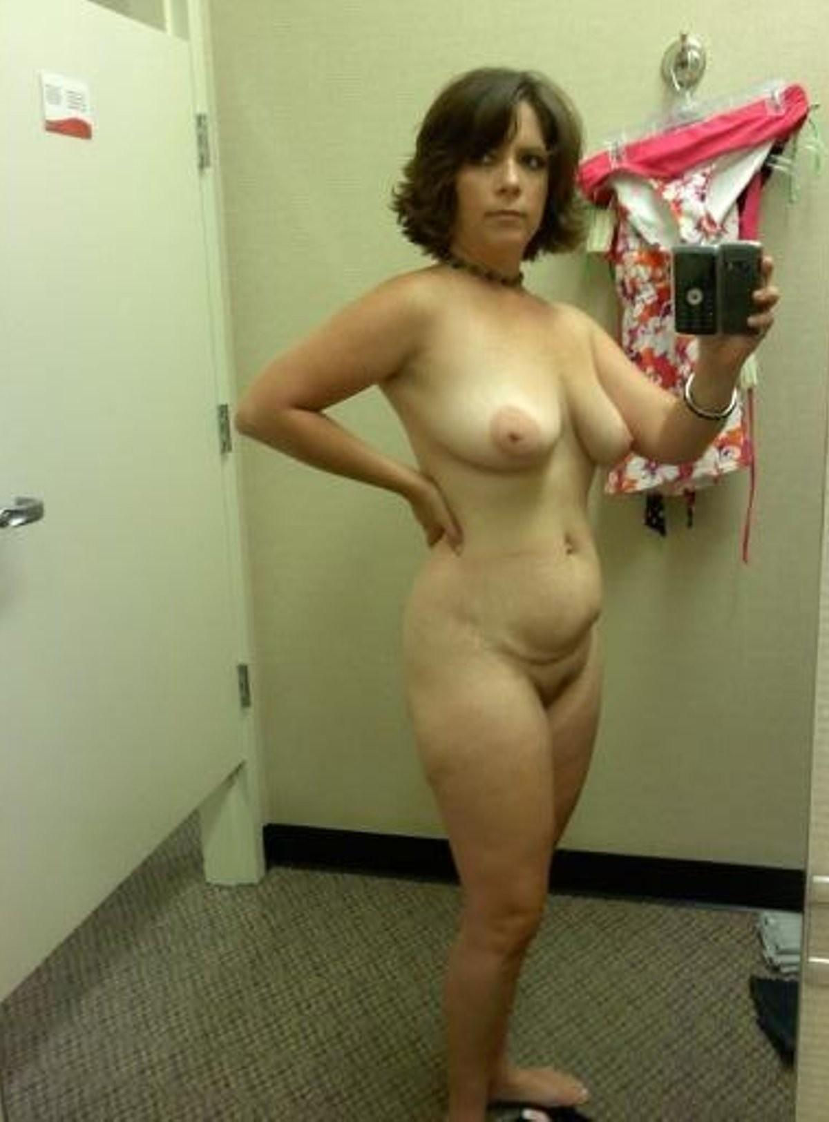 Amateur wife takes mirror selfie while removing dress