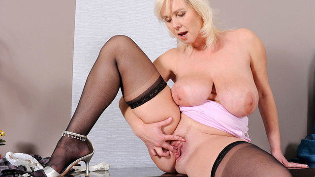 blonde mature pornstar Kimi with big boobs fingering chubby pussy in nylon stockings and high heels