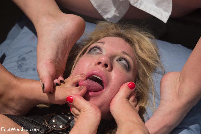Blonde slave pornstar humiliated in a hardcore lesbian foot fetish gangbang porn video