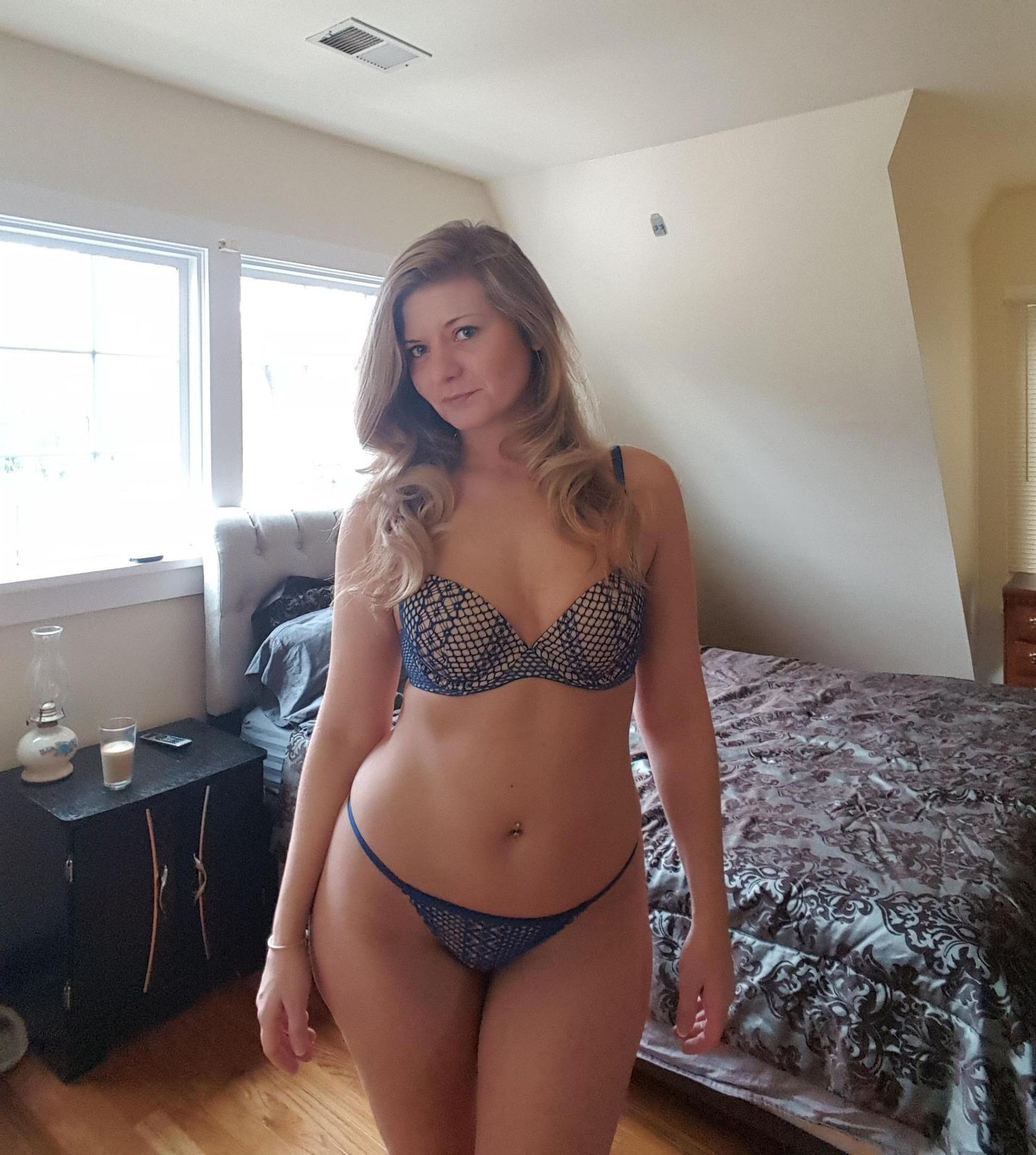 Sexy blonde wife shows her great body in hot lingerie