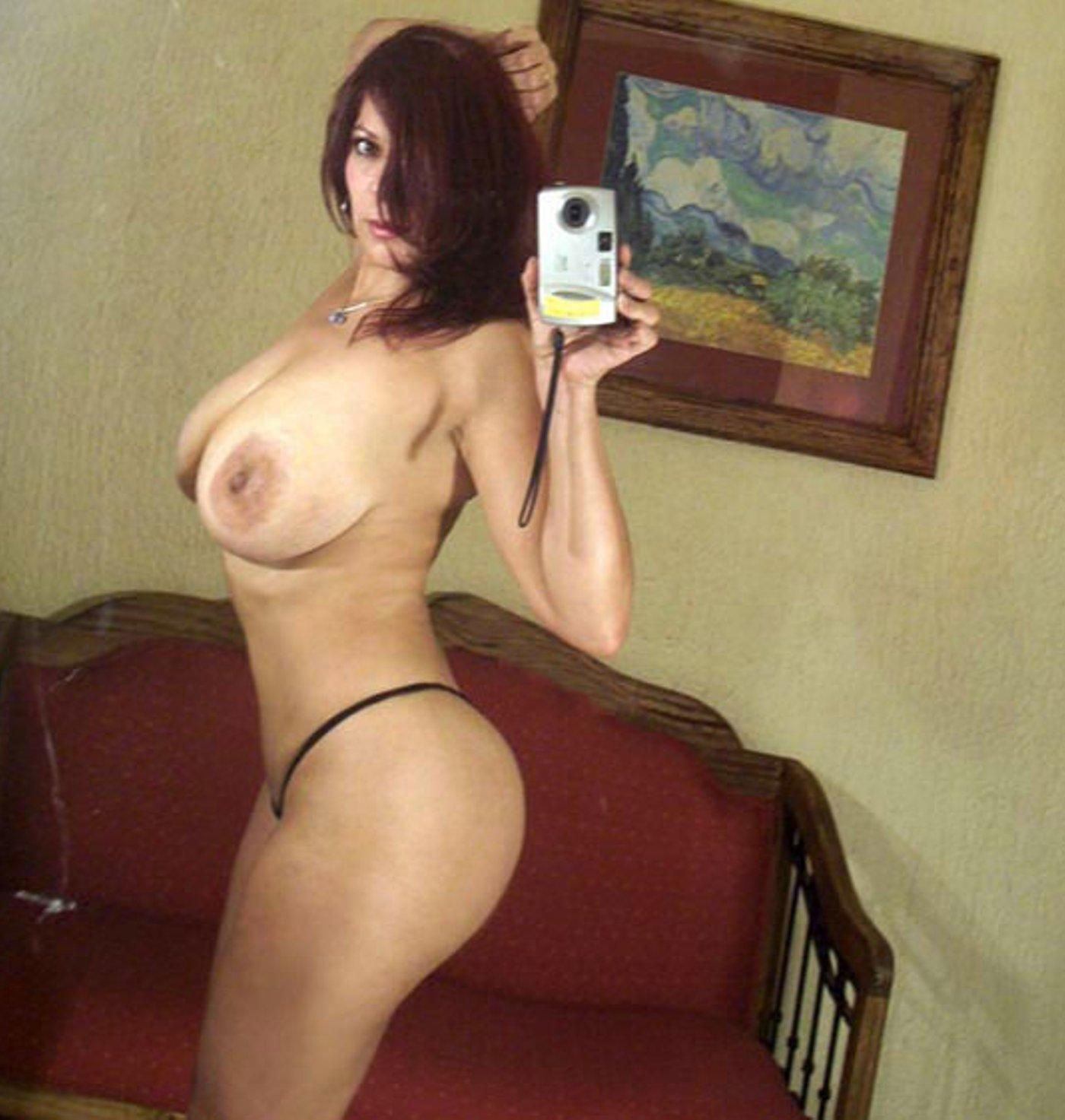 Sexy Maritza Mendez takes a self shot while posing without a bra