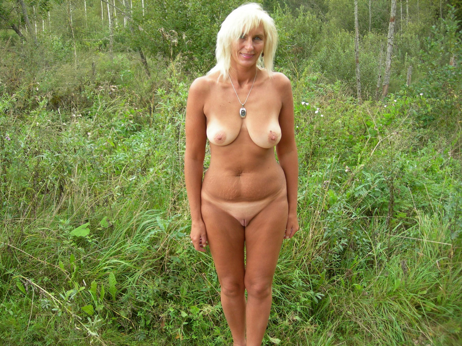 Beautiful wife strips naked for an outdoor