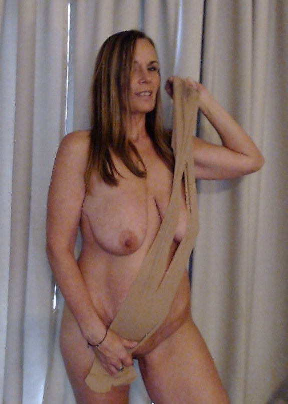 Blonde mature mom KimiKoJo with big tits and shaved pussy playing with pantyhose in amateur home ...