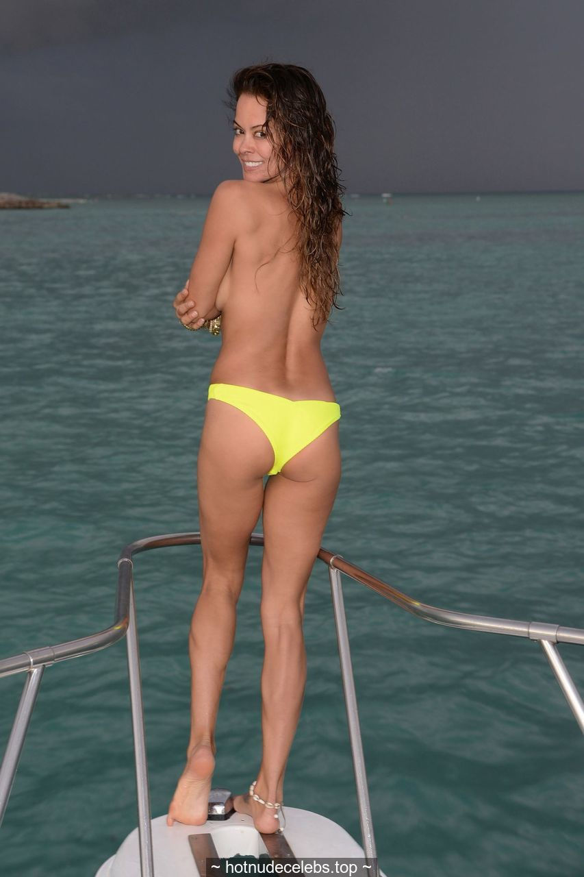 Brooke Burke see through and topless but covered on a yacht in Dominican Republic