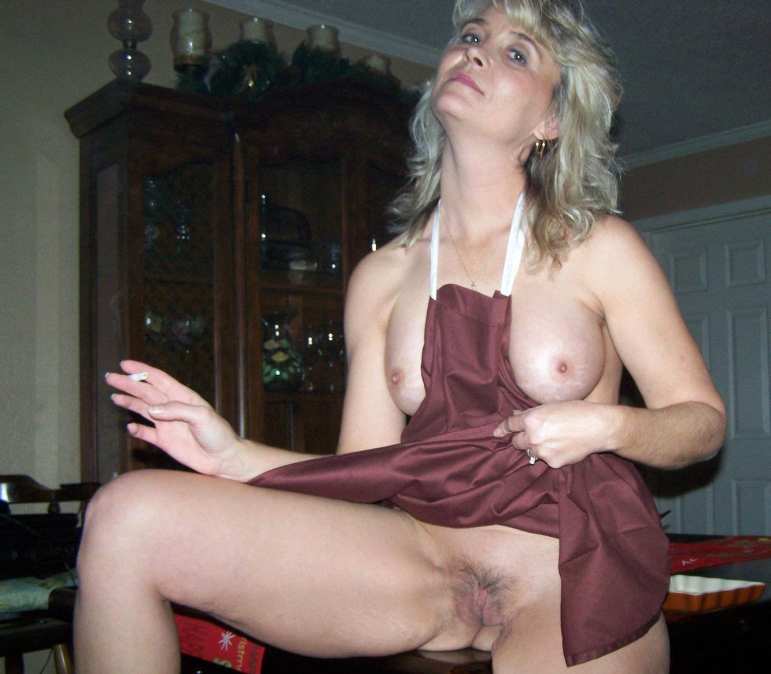 Amateur blonde mature displaying her boobs and pussy