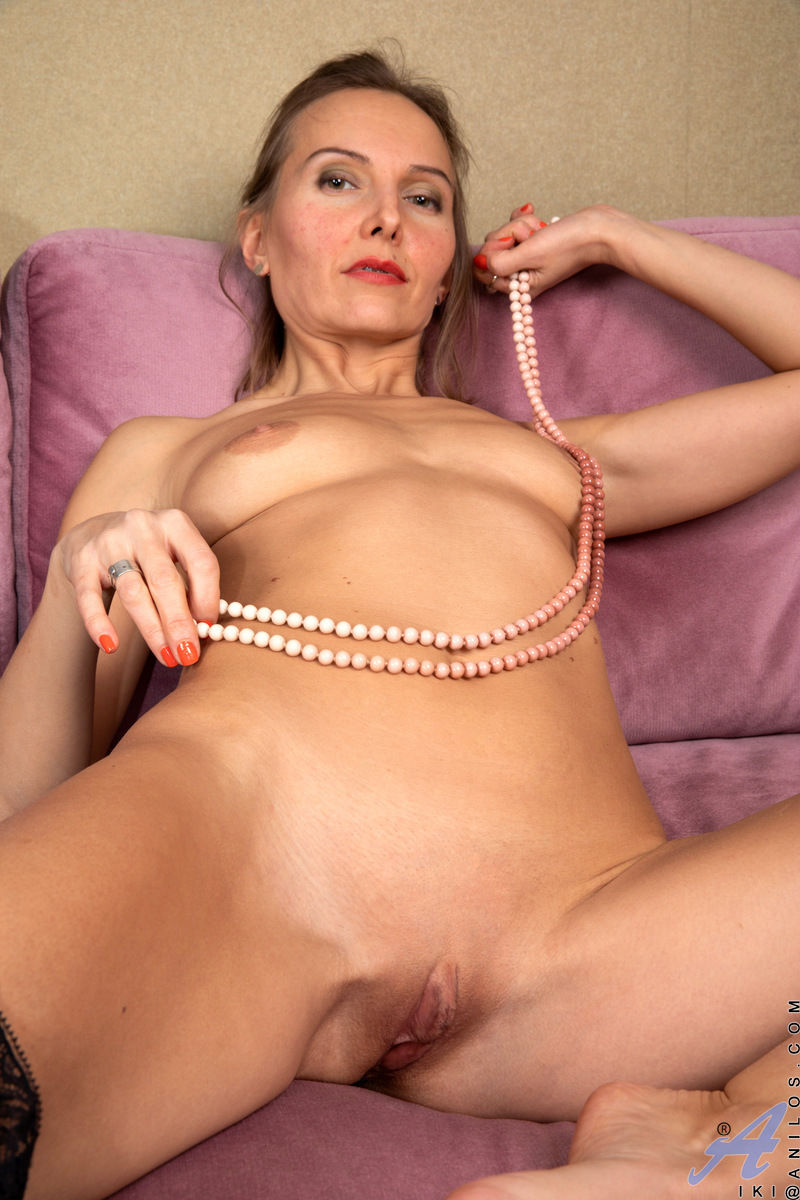 Czech milf pornstar Iki with small tits and shaved mature pussy in free Anilos sex gallery