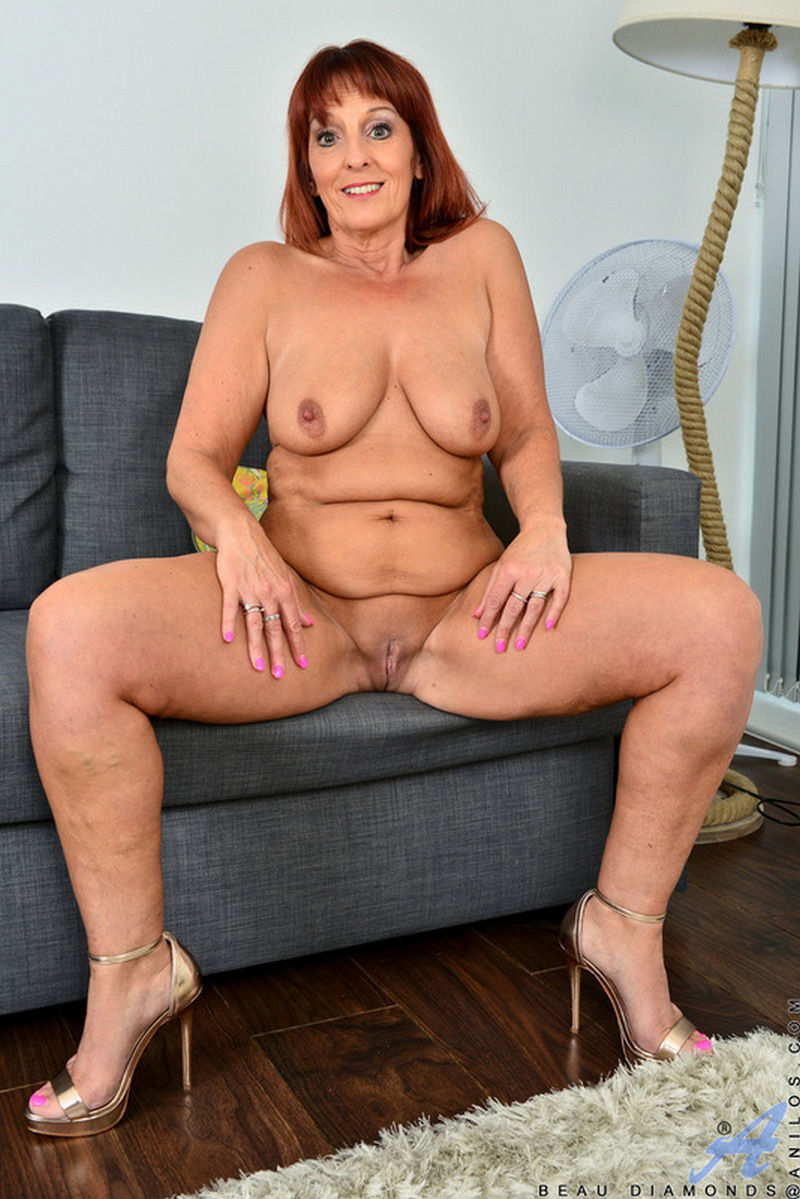 Redhead mature pornstar Beau Diamond with big boobs showing pussy and chubby cameltoe in her Ani ...