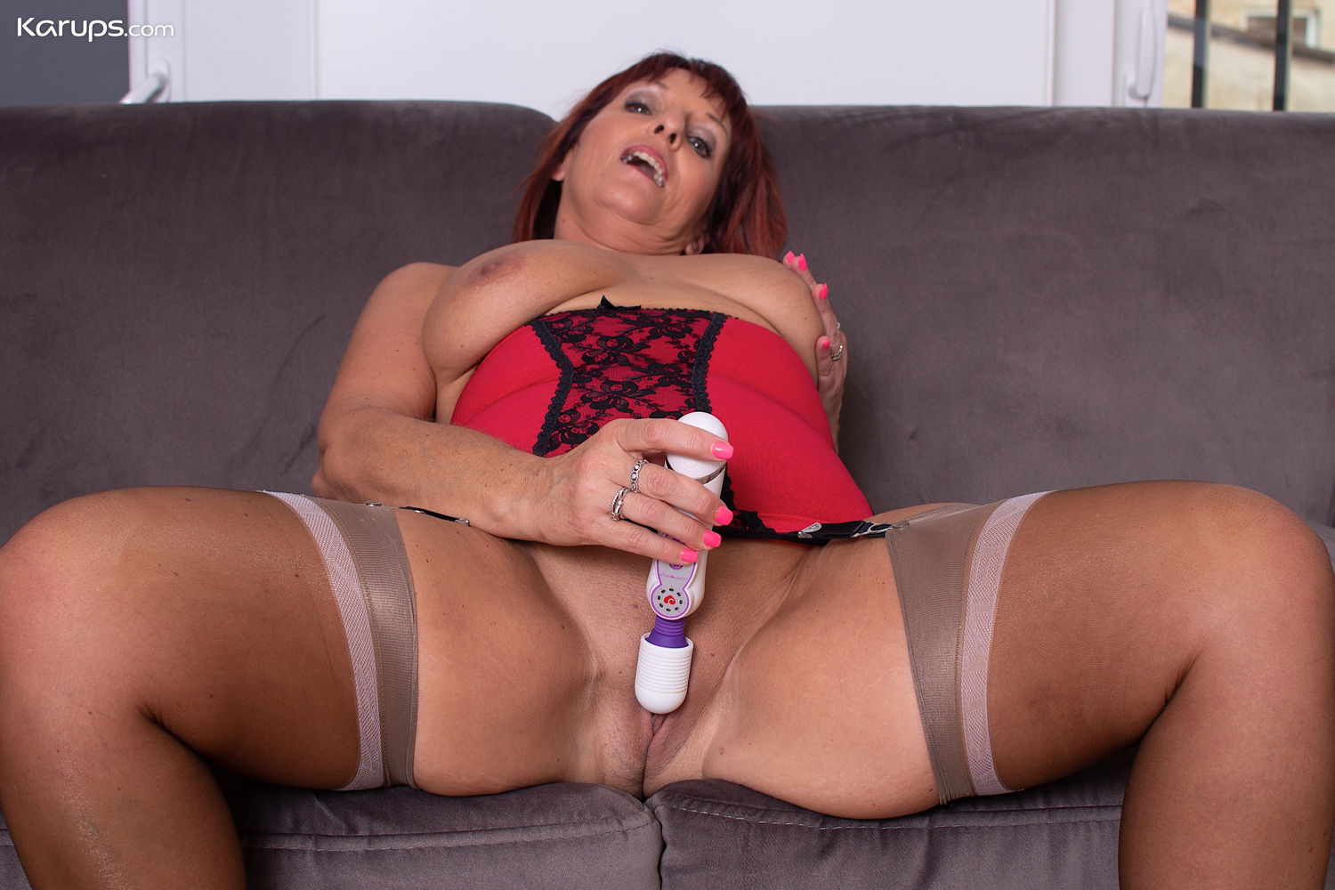 Redhead milf granny Karup pornstar Beau Diamond masturbates in stockings and corsets toying shav ...