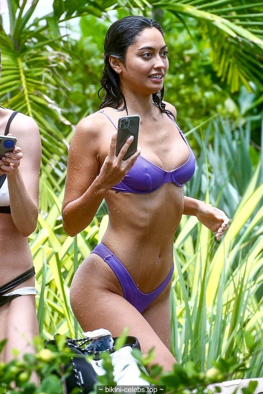 Ambra Gutierrez pokies in wet bikini