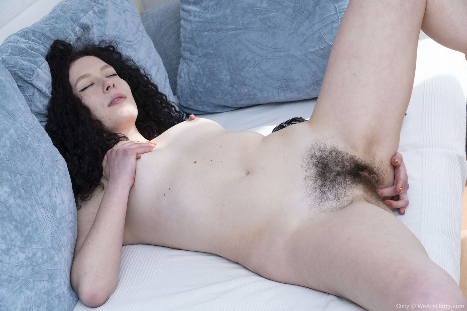 Dark haired amateur sex model fingers hairy pussy and orgasms