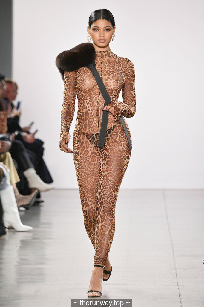 Danielle Herrington braless in see through outfit walks the runway for the LaQuan Smith Fashion  ...